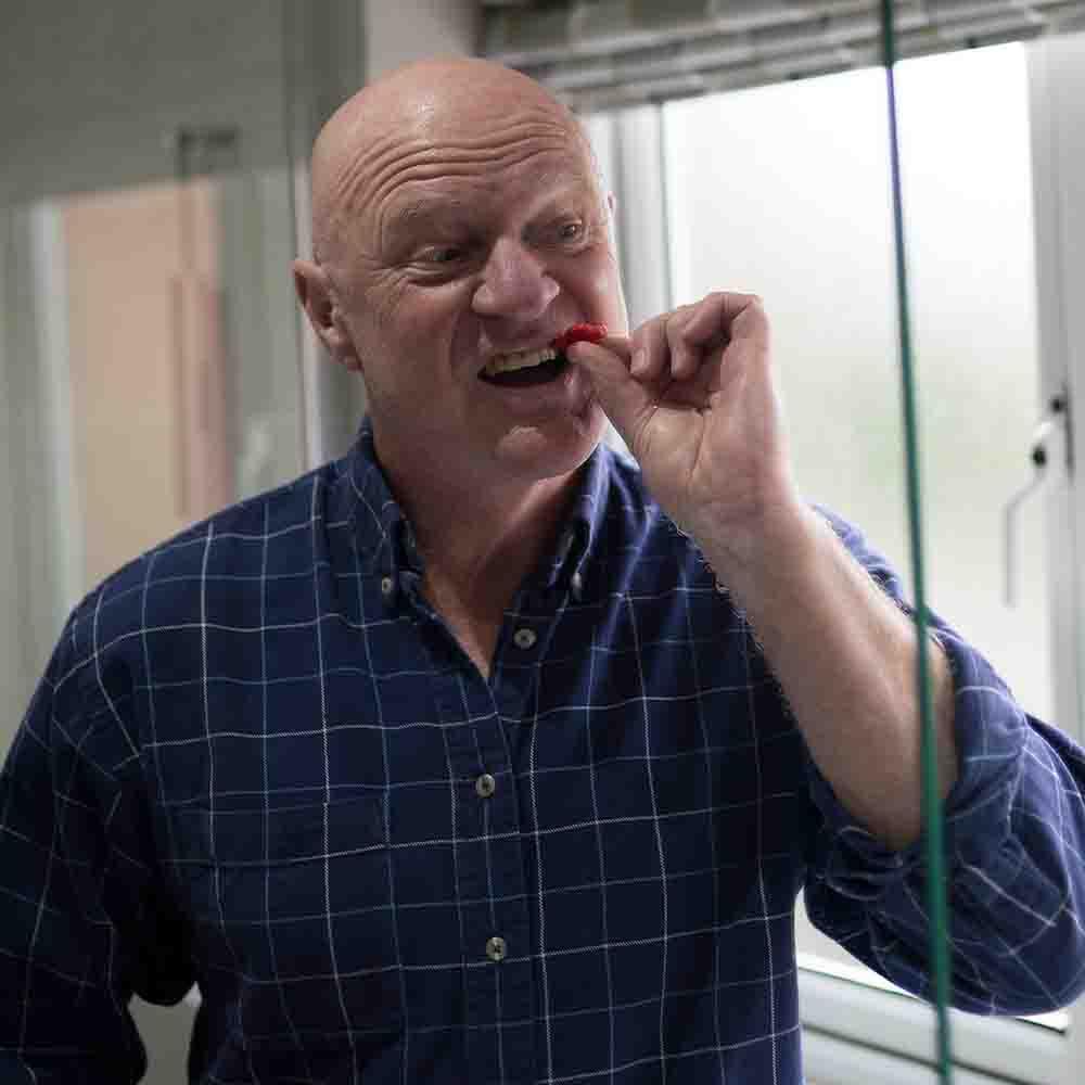 John cleaning teeth