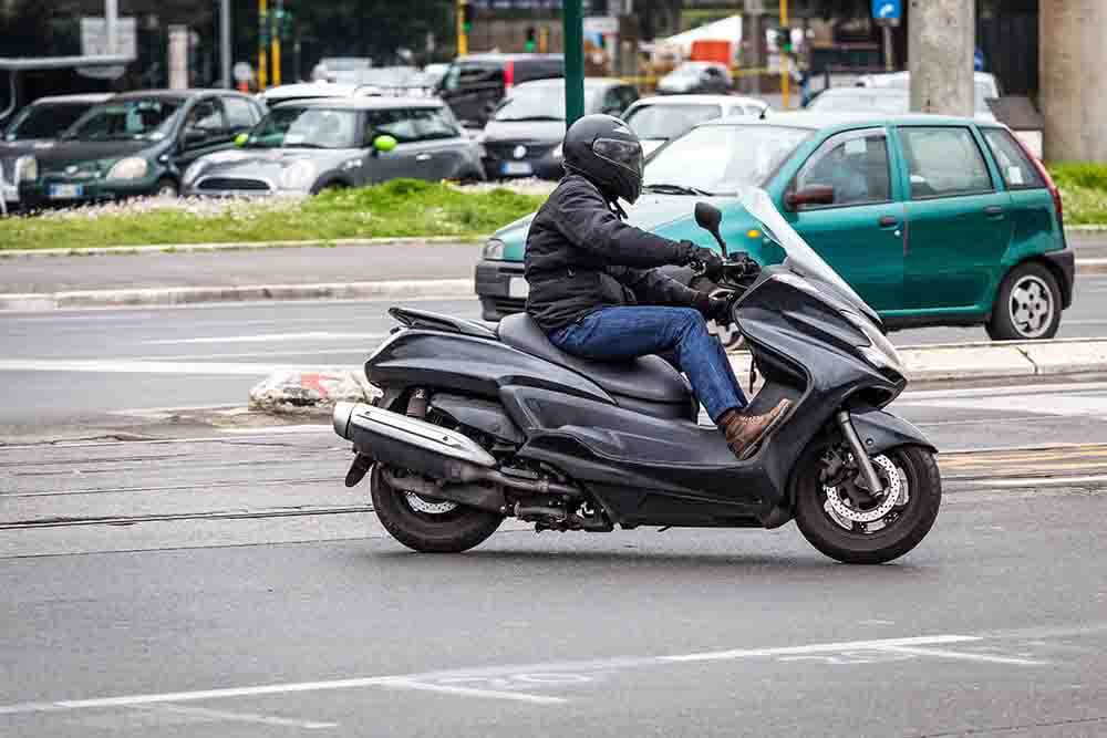Moped rider agrees £28,000 damages settlement with bus operator after oil spillage caused accident and shoulder injury