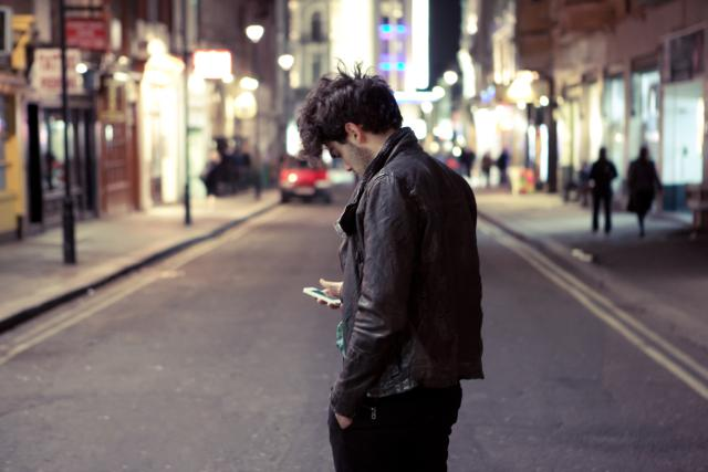 Mobile phone addiction is a real danger as a fifth of young people use them when crossing roads