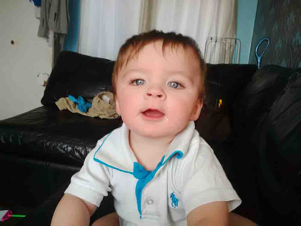 Heartbroken mum says police ripped open teddy bear containing remains of her baby boy and left ashes scattered on bedroom floor