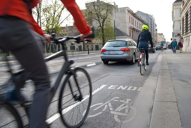 Cyclists commuting in traffic   Cycling safety tips