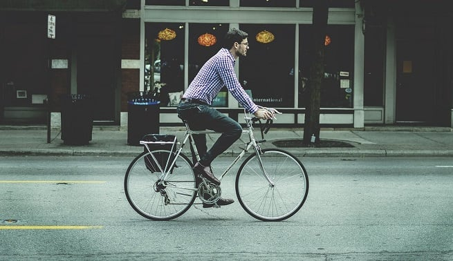 Man commuting by bike   Cycling safety tips