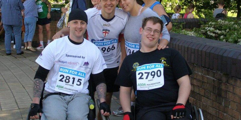 Brain injury victim raises thousands by completing 10k in a wheelchair