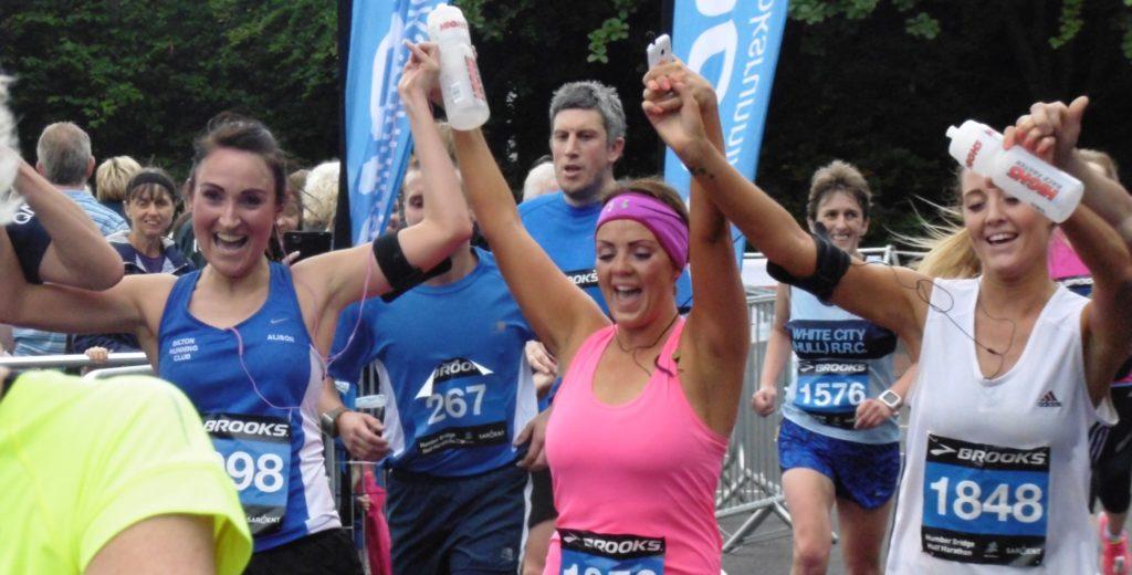 Runners crossing finishing line