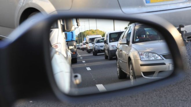 A car wing mirror with a reflection | Road traffic accident claims