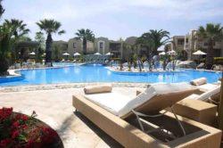 Swimming pool at beautiful vacation holiday resort complex