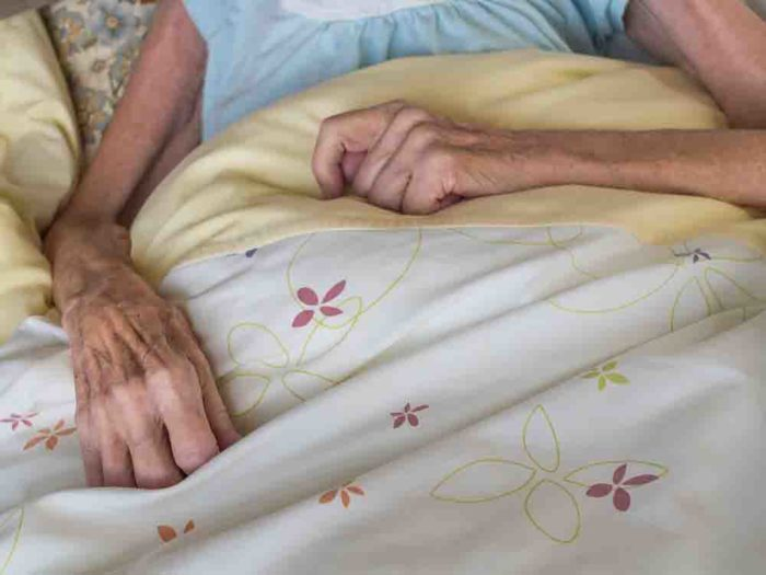 old woman in bed