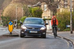 car passing a cyclist