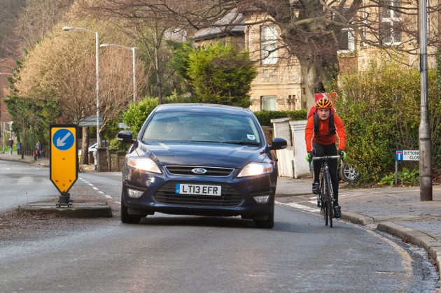 car passing a cyclist