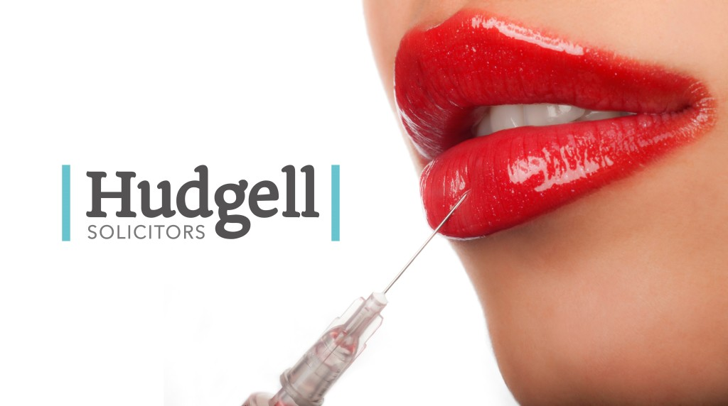 Lips been injected and the Hudgell Logo