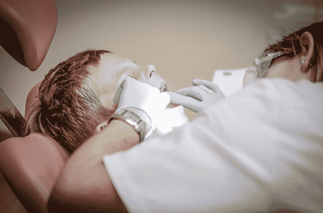 Patient Receiving Treatment from Dentist | Choosing a Dentist | Hudgell Solicitors