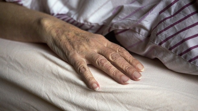 Elderly woman in bed | Hospital negligence leaves woman suffering from serious bed sores