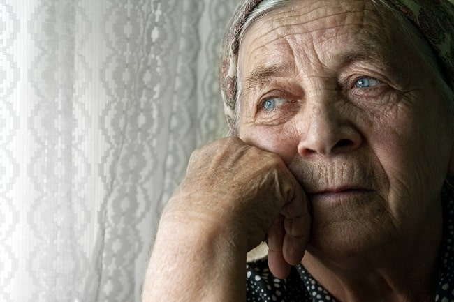 Elderly woman looks sad | One in three care homes failing on safety