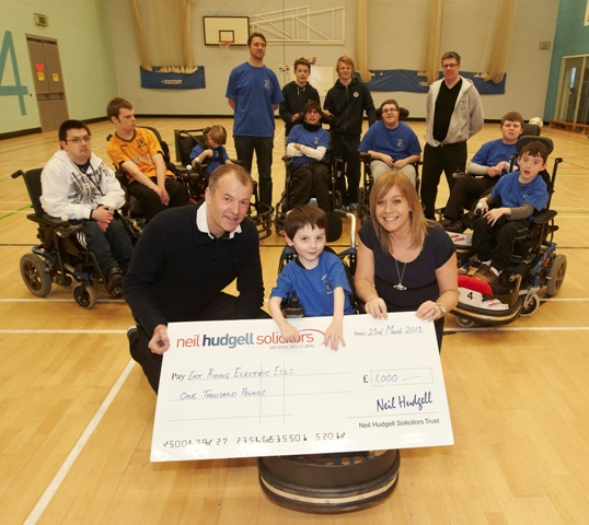 Eels Power chair sport Trust give cheque