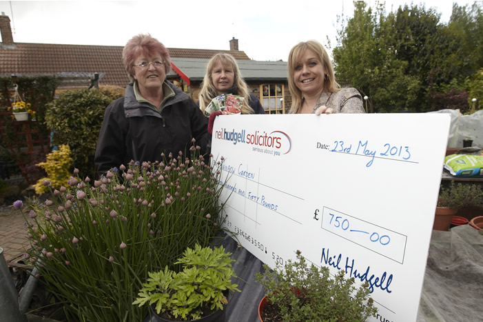 Jo Hudgell with trust cheque to Rainbow garden