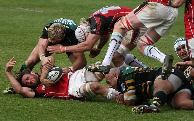 Rugby players tackling | Head Injuries in Sport