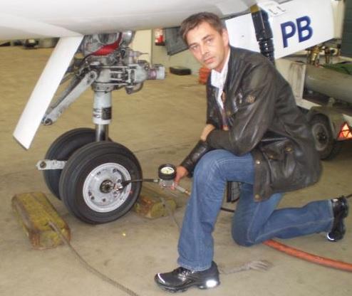 Man pumping up plane tire