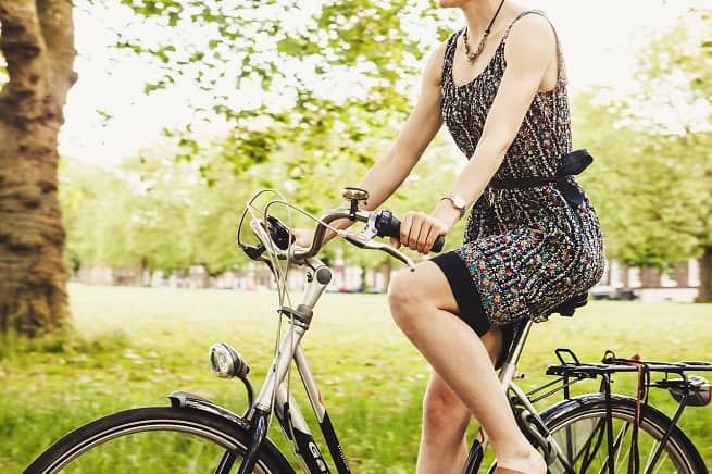 Woman on bike in summer | Cycling Safety Tips